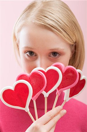 picture of a red lollipop - Young woman with several heart-shaped lollipops Stock Photo - Premium Royalty-Free, Code: 659-03521768