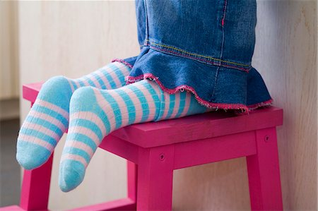 stocking feet - Small girl kneeling on a stool (detail) Stock Photo - Premium Royalty-Free, Code: 659-03522217