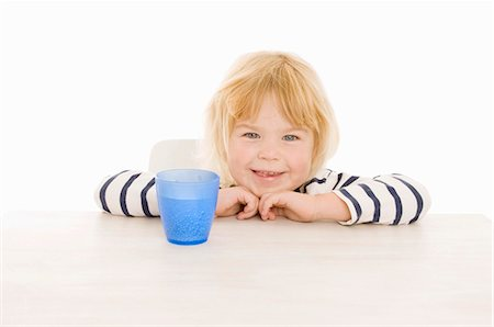 Little girl with beaker of water Stock Photo - Premium Royalty-Free, Code: 659-03522464
