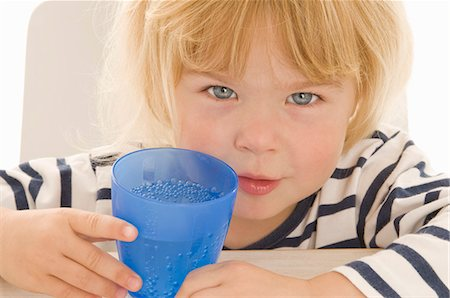 Little girl with beaker of water Stock Photo - Premium Royalty-Free, Code: 659-03522465