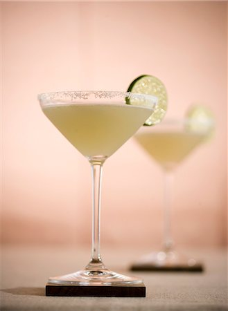 Margarita in a Salted Rim Glass with Lime Garnish Stock Photo - Premium Royalty-Free, Code: 659-03535057