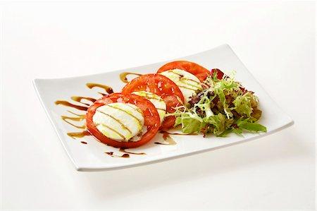 rectangle - Insalata caprese (Tomatoes and mozzarella, Italy) Stock Photo - Premium Royalty-Free, Code: 659-03536074