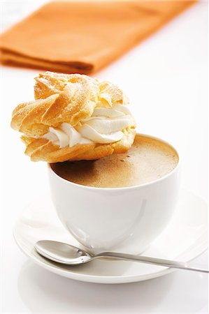 puff - Profiterole on cup of coffee Stock Photo - Premium Royalty-Free, Code: 659-03536480