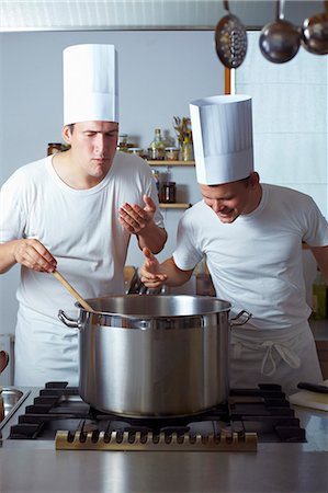 Two chefs standing by range Foto de stock - Sin royalties Premium, Código: 659-03537662
