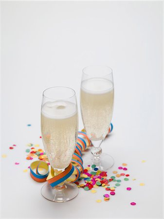 Two glasses of sparkling wine, paper streamer and confetti Stock Photo - Premium Royalty-Free, Code: 659-03530470