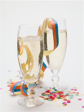 Two glasses of sparkling wine, paper streamer and confetti Stock Photo - Premium Royalty-Free, Code: 659-03530471