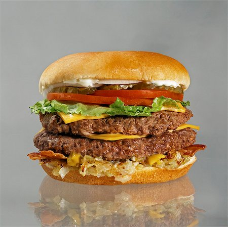 pair - Double Cheeseburger with Bacon, Lettuce, Tomato and Pickles Stock Photo - Premium Royalty-Free, Code: 659-03530558