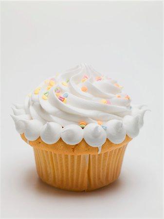 Cupcake with cream and sugar confetti Stock Photo - Premium Royalty-Free, Code: 659-03530699