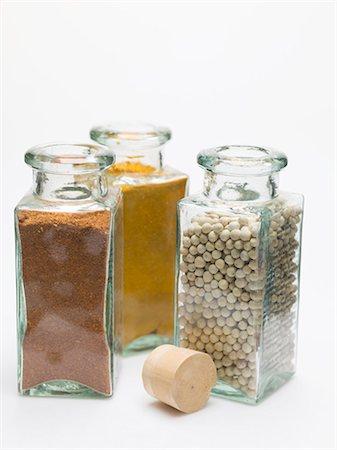 Nutmeg, turmeric, white peppercorns in spice bottles Stock Photo - Premium Royalty-Free, Code: 659-03530803