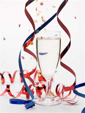 Glass of sparkling wine with party decorations Stock Photo - Premium Royalty-Free, Code: 659-03531012