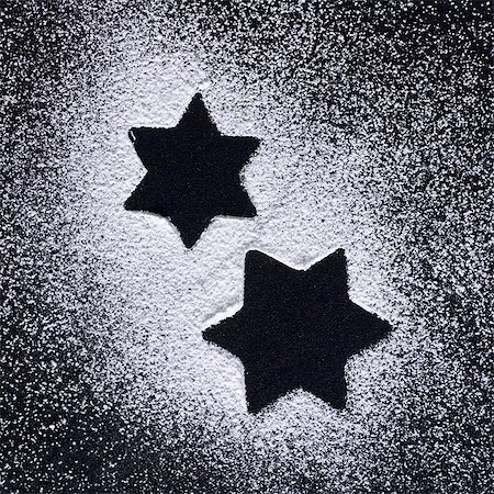 star shape background - Star shapes in icing sugar on black background Stock Photo - Premium Royalty-Free, Code: 659-03532612