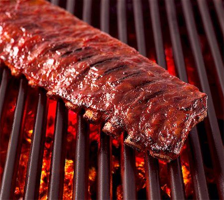 rib - Whole Rack of Pork Ribs on Grill with Barbecue Sauce Stock Photo - Premium Royalty-Free, Code: 659-03533799