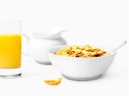 Bowl of cereals and glass of orange juice Stock Photo - Premium Royalty-Free, Code: 652-05808221