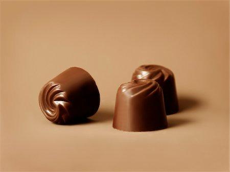 Three chocolates Stock Photo - Premium Royalty-Free, Code: 652-05808888