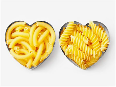 Assorted pasta in heart-shaped biscuit cutters Stock Photo - Premium Royalty-Free, Code: 652-06818797