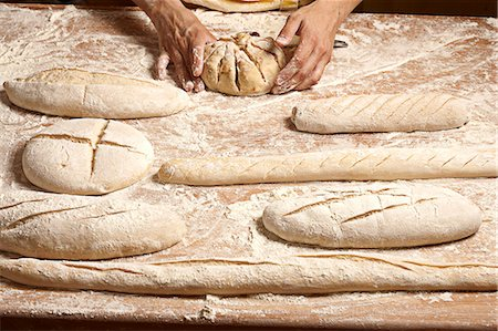 shape - Shaping bread loaves before baking Stock Photo - Premium Royalty-Free, Code: 652-07655754