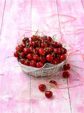 Basket of cherries Stock Photo - Premium Royalty-Free, Code: 652-07656035
