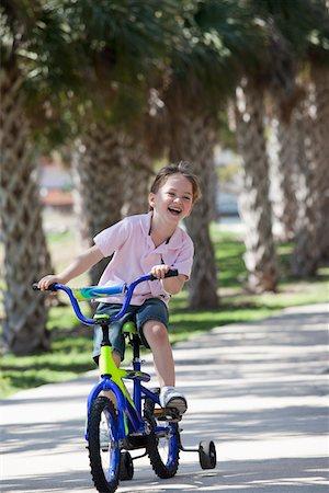 A boy riding a bike Stock Photo - Premium Royalty-Free, Code: 653-05393066
