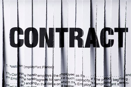 A shredded employment contract, close-up Stock Photo - Premium Royalty-Free, Code: 653-05393094