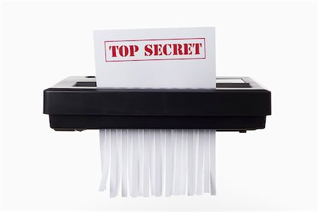 dece11 - A document with TOP SECRET on it being shredded in a paper shredder Stock Photo - Premium Royalty-Free, Code: 653-05393098