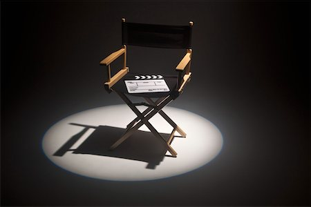 set - A spot lit directors chair and a clapper board Stock Photo - Premium Royalty-Free, Code: 653-05393129