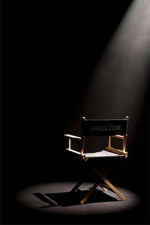 set - A spot lit directors chair Stock Photo - Premium Royalty-Free, Code: 653-05393139