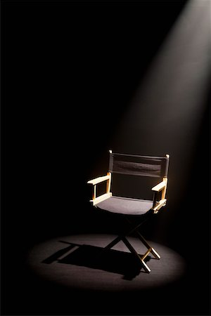 set - A spot lit directors chair Stock Photo - Premium Royalty-Free, Code: 653-05393146