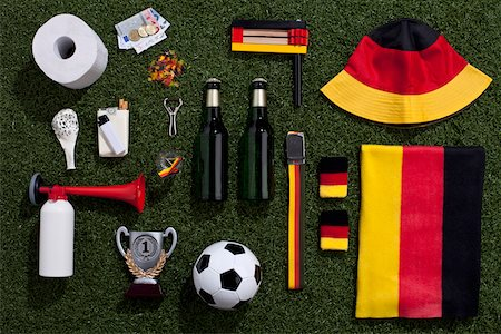 Sporting equipment and accessories arranged on turf Stock Photo - Premium Royalty-Free, Code: 653-05393141