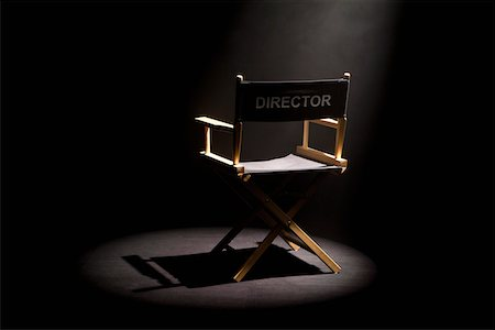 set - A spot lit directors chair Stock Photo - Premium Royalty-Free, Code: 653-05393152