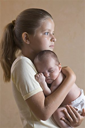 sister - A young girl holding her baby sister closely Stock Photo - Premium Royalty-Free, Code: 653-05393214