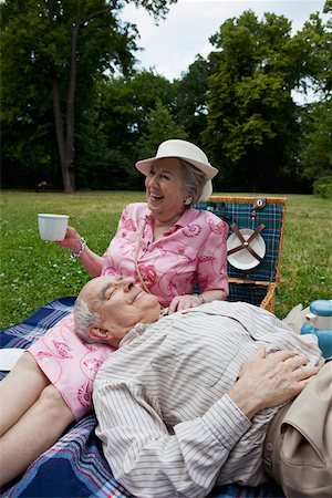 Senior couple have relaxing picnic in the park Stock Photo - Premium Royalty-Free, Code: 653-05393352