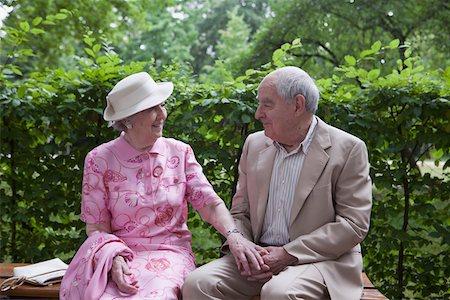 Romantic senior couple on bench in the park Stock Photo - Premium Royalty-Free, Code: 653-05393353
