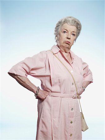 Senior woman with hands on her hips looking disgruntled Stock Photo - Premium Royalty-Free, Code: 653-05393364