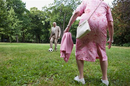 Senior couple play soccer in the park Stock Photo - Premium Royalty-Free, Code: 653-05393367