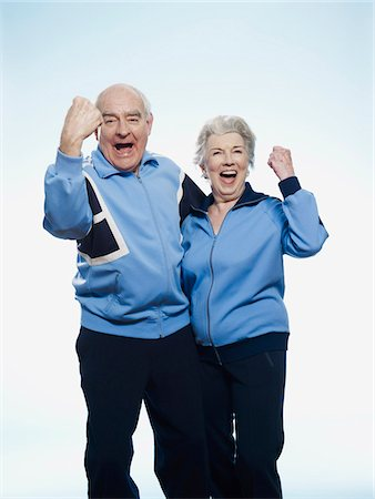Senior man and woman in sportswear cheering Stock Photo - Premium Royalty-Free, Code: 653-05393390
