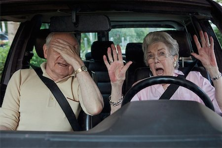 people in panic - Senior woman having trouble learning to drive as man in passenger seat despairs Stock Photo - Premium Royalty-Free, Code: 653-05393393