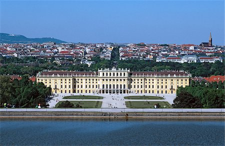 Austria, Vienna, aerial view of Schonbrunn Palace and cityscape behind it Stock Photo - Premium Royalty-Free, Code: 653-05393408