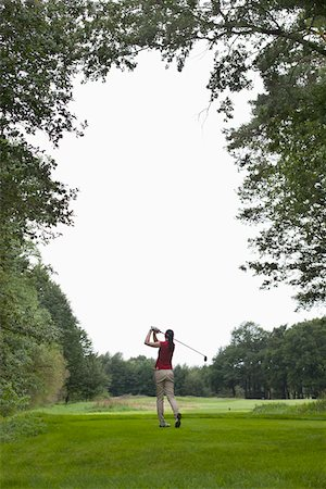 swing (sports) - A female golfer teeing off, rear view Stock Photo - Premium Royalty-Free, Code: 653-05855450