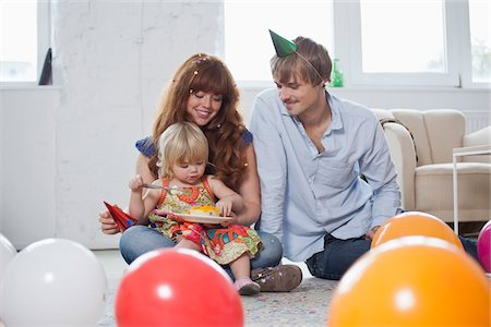 family image and confetti - Two young parents with their daughter, celebrating her birthday Stock Photo - Premium Royalty-Free, Code: 653-05855496