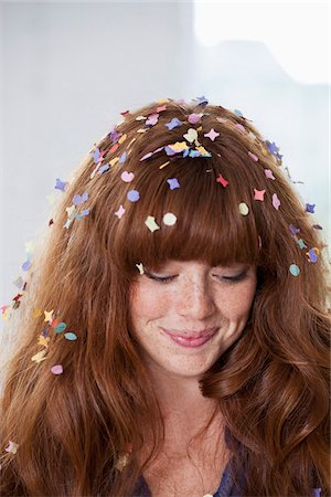 A young woman with confetti in her hair Stock Photo - Premium Royalty-Free, Code: 653-05855533