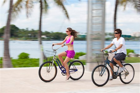 Boy and girl cycling on promenade Stock Photo - Premium Royalty-Free, Code: 653-05975974