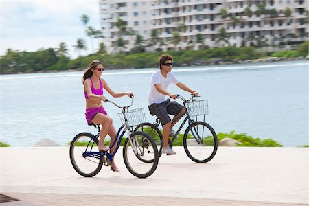 Girl and boy cycling on promenade Stock Photo - Premium Royalty-Free, Code: 653-05975973
