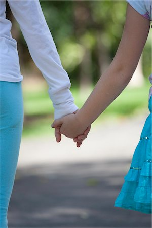 preteen touch - Two girls holding hands Stock Photo - Premium Royalty-Free, Code: 653-05975983