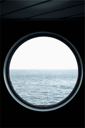 View of the sea through a porthole Stock Photo - Premium Royalty-Free, Code: 653-05976132