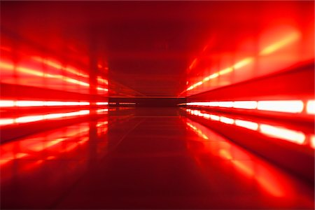 focus on background - An abstract corridor in red tones Stock Photo - Premium Royalty-Free, Code: 653-05976164