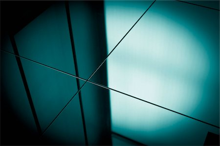 focus on background - Close-up spot lit reflection in blue toned mirrors Stock Photo - Premium Royalty-Free, Code: 653-05976161