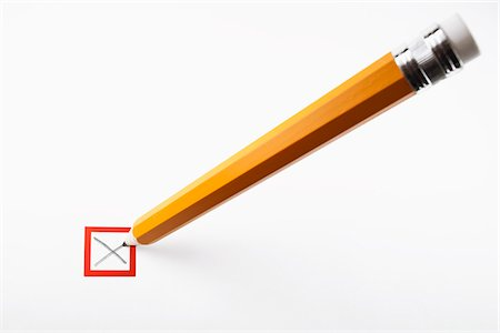 focus on background - Pencil marking an X in a checkbox Stock Photo - Premium Royalty-Free, Code: 653-05976176