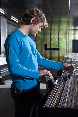 A young man shopping in a record store Stock Photo - Premium Royalty-Free, Code: 653-05976238
