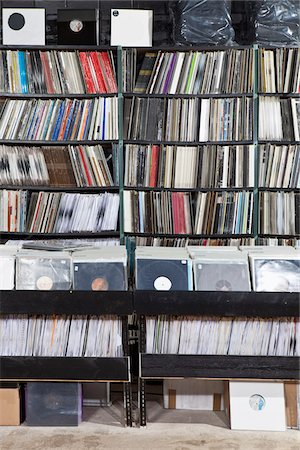 Rows of records on shelves and in bins at a record store Stock Photo - Premium Royalty-Free, Code: 653-05976242