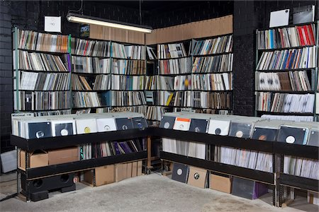 Rows of records on shelves and in bins at a record store Stock Photo - Premium Royalty-Free, Code: 653-05976265